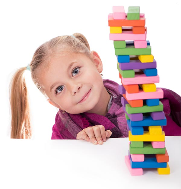 image: girl in purple with blocks